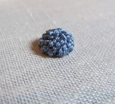 Spiral Trellis was used here to create the Ladybug's body with silk perle thread.       Notice the spiral effect of the stitche...