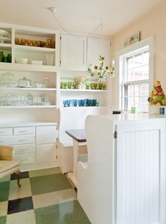 Great for Vacation home/rental...new old vinly design is a kick...bench seating w/cabinet backs...bright kitchen all in white painted wood. Check out the chandelier! Enchanted Storybook - eclectic - Kitchen - Nashville - Kristie Barnett, The Decorologist
