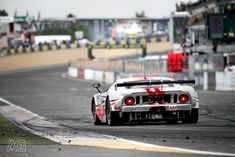 24H du le Mans, 2011- Ford GT. love the depth of field including the track w/ tire debris.