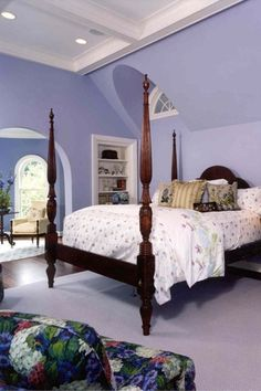 Traditional Master Bedroom with Exposed beam, Built-in bookshelf, Hardwood floors, Standard height, Arched window, can lights