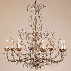 A large scale version of this free form arrangement of crystal buds on a graceful wrought iron frame is suitable for large spaces.