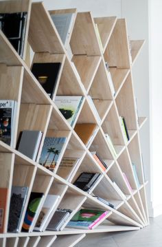 Freestanding double-sided poplar bookcase Manufacturer Studio Pousti