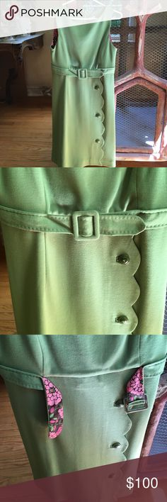 Lilly Pulitzer Green Belt Scalloped Dress Really amazing condition green dress from Lilly Pulitzer! Size 6. The belt is not removable. The lining is a fun pink, brown, and green floral fabric. Scalloped and buttoned front. 70% Acrylic. 30% Wool. Zips up in back. I'm selling for my mom and she only wore it once! Feel free to ask questions! Lilly Pulitzer Dresses