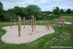 The play area within a landscape of hills and sand