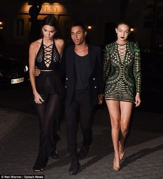 Not alone: Kendall was joined by pal Gigi Hadid and Balmain's Oliver Rousteing during the late night outing