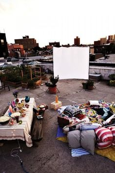 Rooftop Weddings / Love the idea of a casual rooftop reception with picnic style rugs/throws/cushions & a slideshow of your wedding pics! More rooftop wedding venues & inspiration on http://thelane.com/the-guide/style-elements/reception-decor/rooftop-weddings