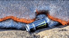 This can of Monster being devoured by lava: | 24 Oddly Satisfying GIFs Of Random Objects Being Destroyed