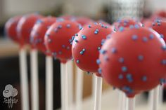 spiderman cake pops ... easier! make red cake pops with blue sprinkles, and pipe on a spider using black icing. yep!