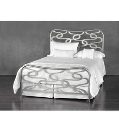 Amalfi by Wesley Allen  Sinuous sculptural ribbons twine and dance in a beautiful abstract pattern in the Amalfi iron bed.