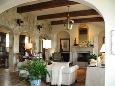 I love this space! The rock walls and rustic details are so warm and inviting.