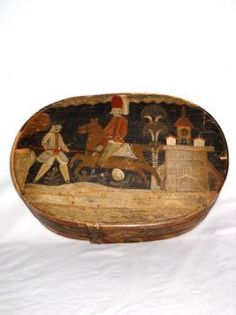 An exceptional decorated bride's box.Painted with a charming narrative scene depicting a red-coated charging horseman confronted by a pikeman in a frock coat and yellow stockings.A wonderful example of Folk Art at its best.This would date late 18th century or early 19th century.More info available.H.7in.,L.18in.,D.12in.     $11,000.00