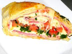 Receita de Enrolado de presunto e queijo. Enviada por Raquel Pereira da Silva e demora apenas 60 minutos.