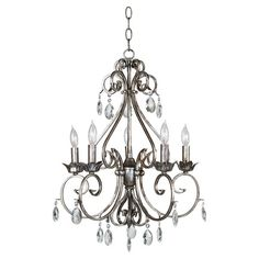 Bring chic style to your living room, dining room, or foyer with this elegant chandelier, showcasing prism-cut glass accents and a scrolling metal frame.  ...