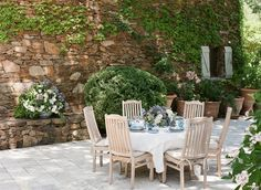 Stone patio with outdoor dining beside rock house. Charleston-based photographer Lucy Cuneo plans an outdoor fête at her Grandmother's breathtaking villa in the South of France. Patio Dining, Outdoor Dining, Outdoor Decor, Dining Room, Outdoor Dinner Parties, Outdoor Entertaining, Love Garden, Home And Garden, Outdoor Garden Rooms
