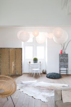 Whitewashed floors and lots of natural, neutral furniture pieces | loving the use of those paper lanterns.