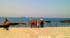Turists just arrived contemplate the amazing blues ....If sky and sea. At Cascais