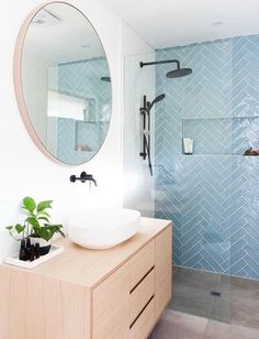 An updated, feminine bathroom idea. Herringbone shower tile in a peaceful aqua contrasts nicely with the round mirror and light wood vanity. So stylish! Laundry In Bathroom, Bathroom Interior Design, Interior, Trendy Bathroom, House Interior, Modern Bathroom, Bathrooms Remodel, Bathroom Decor, Beautiful Bathrooms