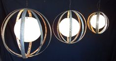 wine barrel rings & rice paper lanterns-this would look great with a glass orb in the middle too.