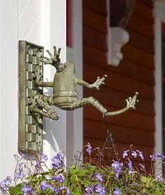 I love this! Jump for joy kind of love this...Meet the new Frog Plant Hanger.