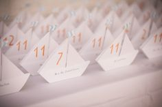Nautical Wedding Details | Escort Cards | On SMP: http://www.stylemepretty.com/massachusetts-weddings/2013/11/20/kittansett-club-wedding-from-zev-fisher-photography |  Photography: Zev Fisher Photography
