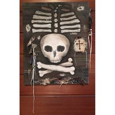 40% OFF! Mr Bones is actively looking for a home. He is painted with acrylic on canvas and is 16x20. He has details of distress and has hanging strings, chains and buttons. His favorite brown plaid surrounds him and a cross hangs nearby for his, and your, protection.  I also take custom orders,