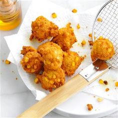 Marina's Golden Corn Fritters Recipe -Just a bite of one of these fritters takes me back to when my kids were young. They're all grown up now, but the tradition lives on at get-togethers, when I double, sometimes triple, the recipe. Serve fritters with maple syrup or agave nectar. —Marina Castle, Canyon Country, California