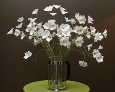 These elegant flowers look like a million but cost only pennies to make. A careful choice of materials and attention to creating graceful shapes combine to make this my favorite paper centerpiece.