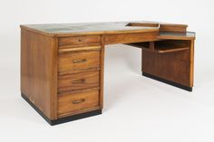 1950 Wooden desk with green asymmetrical formica top and paper holder niche, manufactured in Italy in the 1950s. Original vintage conditions.