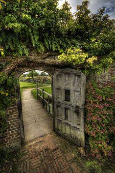 Through the garden gate  Love this reminds me of the secret garden :)