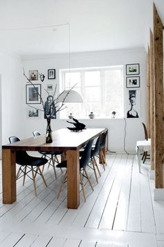 DSW Chairs in a black and white interior with wood accents.