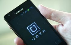 Uber taxi app on a Samsung smartphone - Jeff Blackler/Rex Features