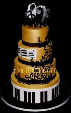 Musical notes dance up the sides of this gold fondant covered cake by thecakeattic.com in Salisbury, NC.