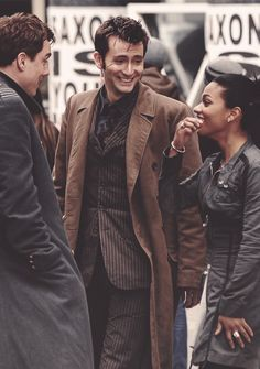 John, David, and Freema on set