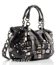 """Coach Purse I'm not a big """"Coach"""" fan (mostly due to the fact that it is RIDICULOUS to spend that kind of money to advertise the infamous """"C"""" for them.. Umm, helloo?! They should be paying ME for that!) Anywayyy... *off my soap box* ...I think I could actually carry this one!! :)"""