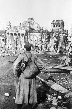 Red Army private Mikail Makarov stares at the ruined Reichstag after the end of the Battle of Berlin. He is carrying the austere bread bag (no backpacks were available for the infantry) and the ever-present PPsh-40 SMG, the only major advantage he and other millions had in the face of the German enemy.
