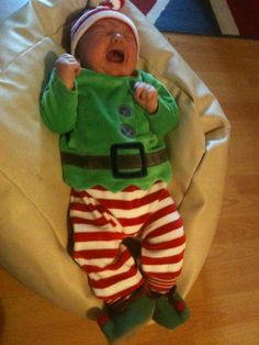 Christmas elf costume, baby wasn't too happy in it, from Next