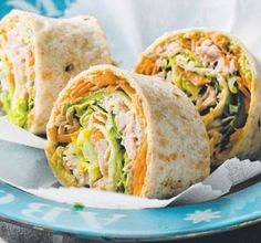 Tuna Salad Rolls - Healthy Snack Recipes:2 wholemeal or multigrain wraps 1 small avocado, mashed 1 small carrot, grated 1 small cucumber, cut into thin ribbons 180g can tuna in springwater, drained, flaked 1 tablespoon whole-egg mayonnaise 2 iceberg lettuce leaves, shredded