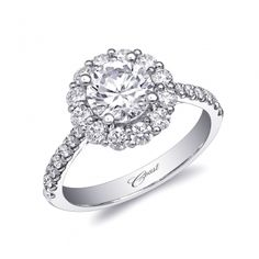 This beautiful round halo engagement ring will surely stand the test of time. Shown with a 1CT center stone.