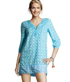 This tunic (H) is super cute with it's embroidered and lace up neckline. Loose and covered in a pretty pattern, this tunic is great for concealment behind the hip in an IWB.