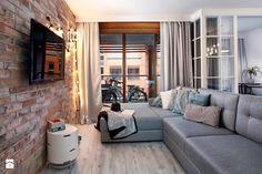 Jasna podłoga, cegły i szarości. Lubimy takie nowoczesne wnętrza! <3 Jeśli planujecie remont lub budowę w nowym roku, koniecznie odwiedźcie http://eurostandard.pl/! Foto: http://www.homebook.pl/inspiracje/salon/249596_-salon-styl-skandynawski