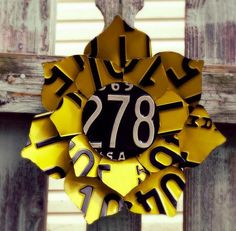 Upcycled Yellow and Black Vintage License Plate Sunflower by LicenseToCraft, $30.00