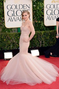 Amy Adams, who is nominated for The Master, is turning heads in this pale pink fishtail Marchesa dress.