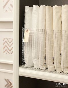 Bold on a Budget: 10 DIY Details to Banish Boring Bathrooms: Wire baskets are great for corralling towels and even bath products, and the project spotted on Home Made by Carmona is a stylish but affordable option!