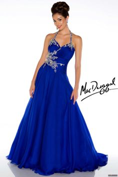 Mac Duggal Style 50155H - Rhinestone halter neckline with rouched fitted bodice opens into a full chiffon skirt with floral bead work adoring the side and halter top. This prom dress is the epitome of style and grace.