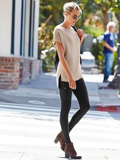 Sweater tunic over zippered tights leggings.
