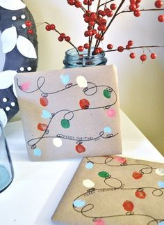 We are loving this homemade Christmas paper. Design using your own thumb prints!