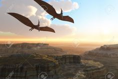 Prehistoric Canyon - Two Pterodactyl flying dinosaurs soar above a beautiful canyon.