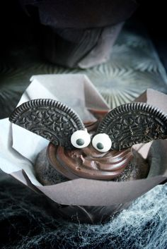 Make a dozen Black Magic Bat Oreo Cupcakes with this Halloween dessert recipe.
