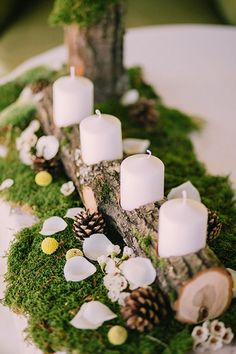 wedding winter wedding decorations candlestick from a wooden branch with white candles surrounded by pine cones on a green moss muse books via Christmas Wedding Centerpieces, Winter Wedding Decorations, Rustic Centerpieces, Christmas Decorations, Table Decorations, Moss Wedding Decor, Centerpiece Ideas, Wedding Ideas Christmas, Moss Decor