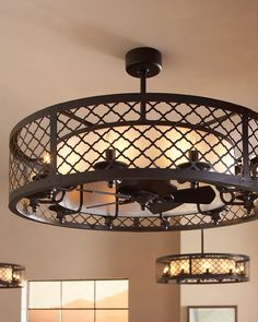 "The Brighton Court Collection: The unique design of the Brighton Court ceiling fan is classified as a ""fandelier"" – a decorative exterior shade covering a small, gentle fan within.  The outer basket weave metal shade has a high-end, rustic look inspired by the Mountain Luxe design trend. The inner fabric shade conceals the fan and is surrounded by ten integrated lights using candelabra bulbs."